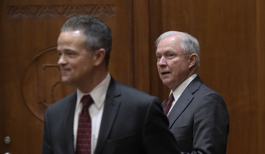 Attorney General Jeff Sessions, right, following Attorney general Chief of Staff Jody Hunt, left, arrives for a meeting with the heads of federal law enforcement components at the Department of Justice in Washington, Thursday, Feb. 9, 2017. (AP Photo/Susan Walsh, Pool)