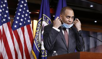 In this file photo, Democratic Caucus Chairman Rep. Hakeem Jeffries of N.Y., removes on a face mask to protect against the spread of the new coronavirus before answering a reporter's question during a news conference on Capitol Hill in Washington, Monday, June 29, 2020. (AP Photo/Patrick Semansky)  **FILE**