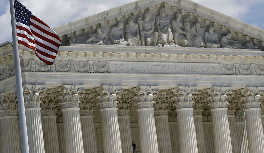 An American flag waves in front of the Supreme Court on Capitol Hill in Washington, Monday, June 29, 2020. (AP Photo/Patrick Semansky)