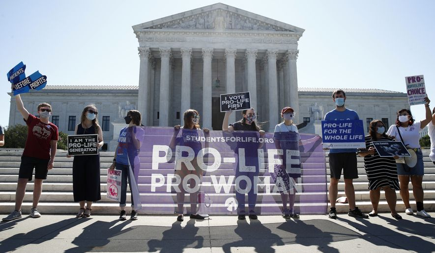 Anti-abortion protesters wait outside the Supreme Court for a decision, Monday, June 29, 2020 in Washington on the Louisiana case, Russo v. June Medical Services LLC. (AP Photo/Patrick Semansky)
