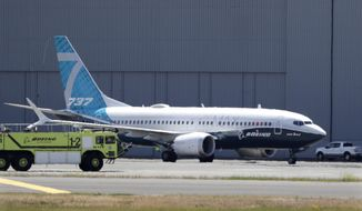 A Boeing 737 MAX jet taxis after landing at Boeing Field following a test flight Monday, June 29, 2020, in Seattle. The jet took off from Boeing Field earlier in the day, the start of three days of re-certification test flights that mark a step toward returning the aircraft to passenger service. The Federal Aviation Administration test flights over the next three days will evaluate Boeing's proposed changes to the automated flight control system on the MAX, a system that activated erroneously on two flights that crashed, killing 346 people. (AP Photo/Elaine Thompson)