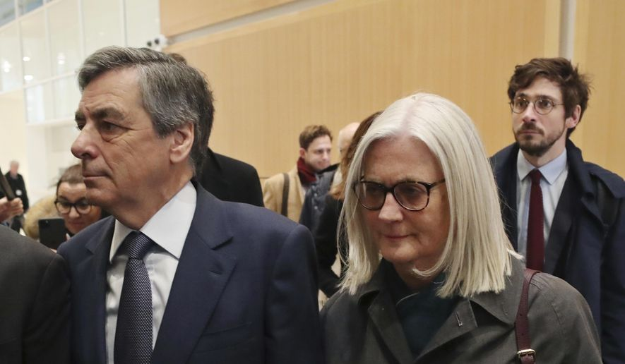 In this Feb. 26, 2020, file photo, France's former Prime Minister Francois Fillon, left, and his wife Penelope, arrive at the Paris courthouse, in Paris. (AP Photo/Thibault Camus, File)