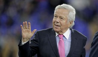 In this Nov. 3, 2019, file photo, New England Patriots owner Robert Kraft waves to fans as he walks on the field prior to the team's NFL football game against the Baltimore Ravens in Baltimore. Florida prosecutors will try to save their prostitution solicitation case against Kraft when they argue before an appellate court Tuesday, June 30, 2020, that his rights weren't violated when police secretly video recorded him allegedly paying for sex at a massage parlor. (AP Photo/Julio Cortez, File)  **FILE**