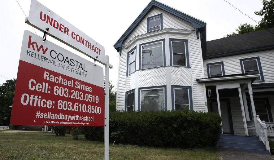 "FILE - In this June 20, 2018, file photo, an ""Under Contract"" sign is displayed in front of home for sale in Raymond, N.H. The number of Americans signing contracts to buy homes rebounded a record 44.3% in May after a record-breaking decline the previous month, as the impact of the coronavirus pandemic sidelined both buyers and sellers. The National Association of Realtors said Monday, June 29, 2020, that its index of pending sales rose to 99.6 in May, the highest month-over-month gain in the index since its inception in January 2001.(AP Photo/Charles Krupa, File)"