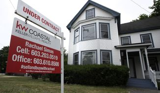 """FILE - In this June 20, 2018, file photo, an """"Under Contract"""" sign is displayed in front of home for sale in Raymond, N.H. The number of Americans signing contracts to buy homes rebounded a record 44.3% in May after a record-breaking decline the previous month, as the impact of the coronavirus pandemic sidelined both buyers and sellers. The National Association of Realtors said Monday, June 29, 2020, that its index of pending sales rose to 99.6 in May, the highest month-over-month gain in the index since its inception in January 2001.(AP Photo/Charles Krupa, File)"""