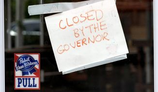 "A sign on the door of the West Alabama Icehouse reads ""Closed by the Governor"", Monday, June 29, 2020, in Houston. Texas Gov. Greg Abbott shut down bars again and scaled back restaurant dining on Friday as cases climbed to record levels after the state embarked on one of America's fastest reopening. (AP Photo/David J. Phillip) ** FILE **"