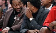 FILE - In this Dec. 23, 2019, file photo, injured Washington Wizards' John Wall, left, talks to an also injured teammate as they sit on the bench during the second half of an NBA basketball game against the New York Knicks in New York. The Wizards have ruled out the possibility of star guard Wall playing when the NBA season resumes. General manager Tommy Sheppard says Wall will not travel with the team to Walt Disney World in Central Florida to restart the season. Wall has not played an NBA game since December 2018. He tore his left Achilles tendon and needed another operation in 2019. (AP Photo/Kathy Willens, File)
