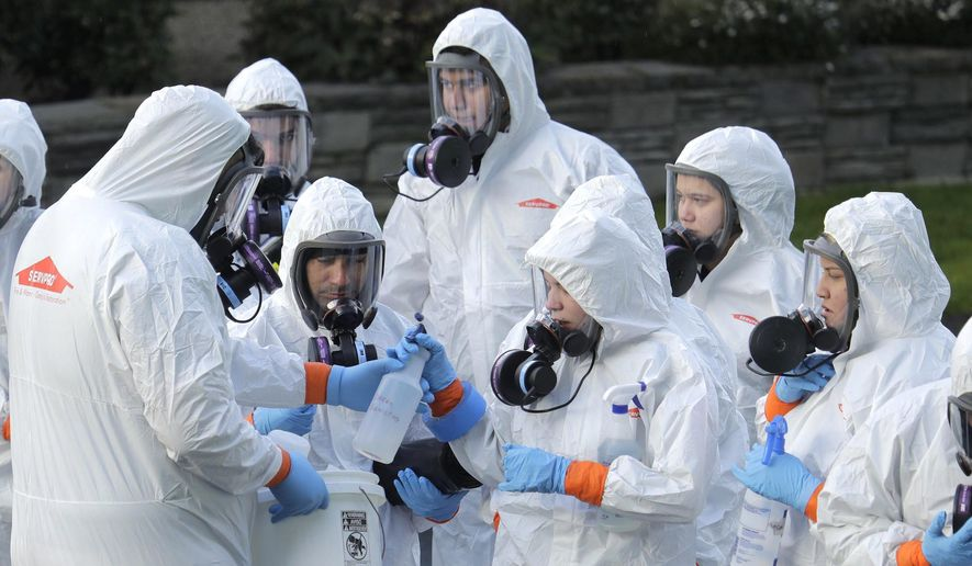 A sizable number of Americans have heard conspiracy theories about the origins of the coronavirus, according to a Pew Research Center poll. (Associated Press)