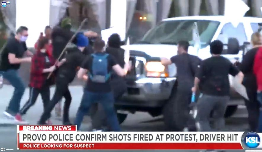Black Lives Matter protesters surround a vehicle in Provo, Utah, June 29, 2020. A suspect can be seen rushing the passenger side of an SUV prior to shooting the driver. (Image: KSL-5 NBC video screenshot)