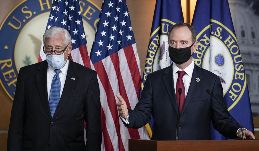 Rep. Adam Schiff, D-Calif., chairman of the House Intelligence Committee, right, speaks accompanied by House Majority Leader Steny Hoyer of Md., during a news conference on Capitol Hill, after a meeting at the White House, Tuesday, June 30, 2020, in Washington. (AP Photo/Alex Brandon)