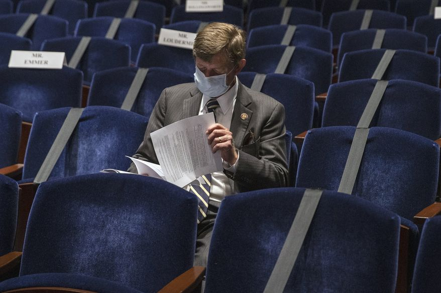 Rep. Scott Tipton, R-Colo., listens during a House Financial Services Committee hearing on the coronavirus response on Capitol Hill in Washington, Tuesday, June 30, 2020. (Tasos Katopodis/Pool via AP)