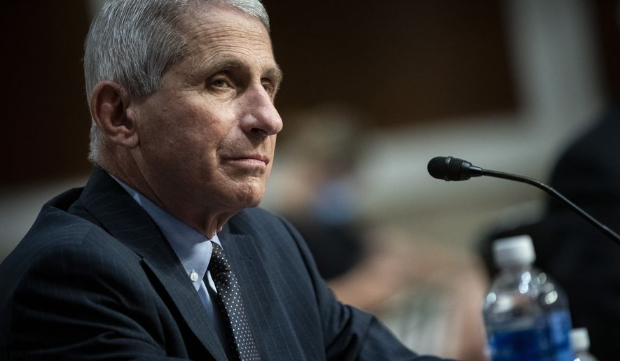 Director of the National Institute of Allergy and Infectious Diseases Dr. Anthony Fauci listens during a Senate Health, Education, Labor and Pensions Committee hearing on Capitol Hill in Washington, Tuesday, June 30, 2020. (Al Drago/Pool via AP)