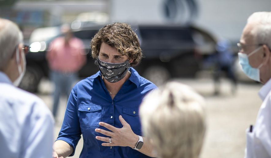 In this June 22, 2020, file photo, Amy McGrath, a candidate for the Democratic nomination to U.S. Senate, speaks to people during a visit to Thankful Hearts Food Pantry in Pikeville, Ky. (Ryan C. Hermens/Lexington Herald-Leader via AP, File)
