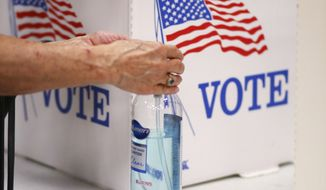 Hand cleaner for voters after voting at precinct 61 in Edmond, Tuesday, June 30, 2020. (Doug Hoke/The Oklahoman via AP)