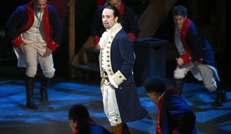 "FILE - In this June 12, 2016 file photo, Lin-Manuel Miranda and the cast of ""Hamilton"" perform at the Tony Awards in New York. A filmed version of the original Broadway production will be available Friday, July 3, on Disney Plus. (Photo by Evan Agostini/Invision/AP, File)"