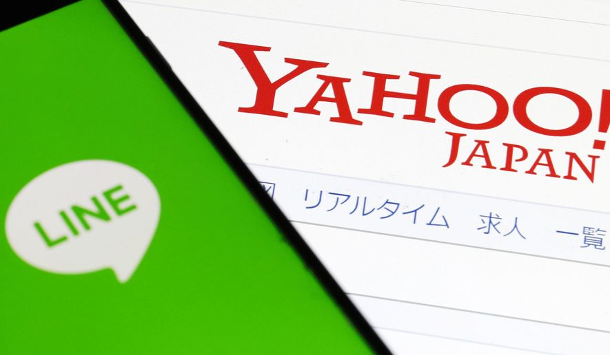 FILE - This Nov. 15, 2019, file photo shows logs of Yahoo Japan and Line Corp. in Tokyo. Online services Yahoo Japan and Line Corp. said Tuesday, June 30, 2020, the fallout from the coronavirus pandemic is causing delays that will push back their merger to later than the scheduled October date. (Shinji Kita/Kyodo News via AP, File)