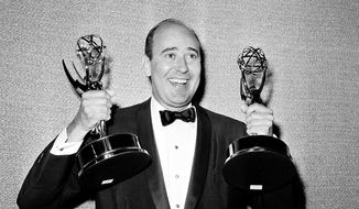 """In this May 26, 1963, file photo, Carl Reiner shows holds two Emmy statuettes presented to him as best comedy writer for the """"Dick Van Dyke Show,"""" during the annual Emmy Awards presentation in Los Angeles. Reiner, the ingenious and versatile writer, actor and director who broke through as a """"second banana"""" to Sid Caesar and rose to comedy's front ranks as creator of """"The Dick Van Dyke Show"""" and straight man to Mel Brooks' """"2000 Year Old Man,"""" has died, according to reports. Variety reported he died of natural causes on Monday night, June 29, 2020, at his home in Beverly Hills, Calif. He was 98. (AP Photo, File)"""