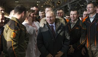 In this March 6, 2018, file photo, Russian President Vladimir Putin listens to employees of Uralvagonzavod factory in Nizhny Tagil, Russia. (AP Photo/Alexander Zemlianichenko, File)