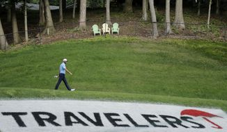 Dustin Johnson walks away from the 15th tee box after teeing off during the final round of the Travelers Championship golf tournament at TPC River Highlands, Sunday, June 28, 2020, in Cromwell, Conn. (AP Photo/Frank Franklin II)