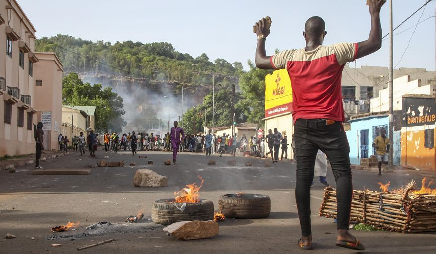 FILE - In this June 19, 2020, file photo, protesters demanding President Ibrahim Boubacar Keita's resignation take to the streets in the capital Bamako, Mali.  The U.N. Security Council voted unanimously Monday, June 29, to extend the mandate of the 15,600-strong  U.N. peacekeeping force in Mali for a year and called for a long-term road map with benchmarks and conditions for the force to hand over security responsibilities and leave the West African nation. Mali has been in turmoil since a 2012 uprising prompted mutinous soldiers to overthrow the president of a decade. (AP Photo/Baba Ahmed, File)