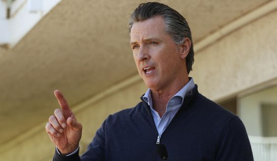 """Gov. Gavin Newsom gives an update on the state's initiative to provide housing for homeless Californians to help stem the coronavirus, during a visit to a Motel 6 participating in the program in Pittsburg, Calif., Tuesday, June 30, 2020. Newsom announced that more than 15,000 rooms have been acquired and more than 14,000 people have been given places to stay statewide under the Project Room key program started in April. The governor also said he plans to announce on Wednesday plans to """"toggle back"""" the states stay-at-home order. (AP Photo/Rich Pedroncelli, Pool)"""