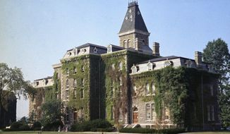FILE- In this Aug. 28, 1973, file photo, McGraw Hall stands on the campus of Cornell University in Ithaca, N.Y. As colleges around the country grapple with how to reopen in the fall, on Tuesday, June 30, 2020, Cornell's president announced that it will welcome students back to campus, an option she said is best not only for their education, but also public health. (AP Photo/Jonathan Jay Fink)
