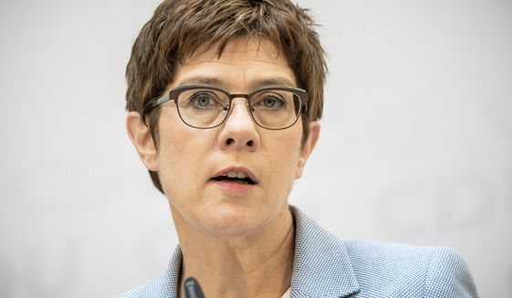 Annegret Kramp-Karrenbauer, Christian Democratic Union, CDU, party chairwoman and German Minister of Defence, speaks at a news conference  following a CDU leaders meeting at the headquarters in Berlin, Germany, Monday, June 8, 2020. (Michael Kappeler/dpa via AP)