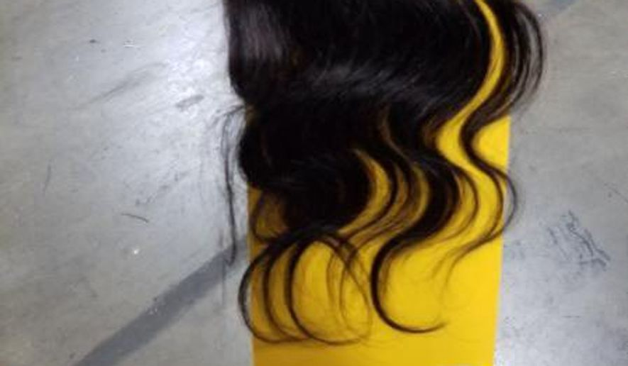 U.S. customs inspectors recently seized a 13-ton shipment of human hair that is suspected to be from Uighur concentration camps in China. (Customs and Border Protection)