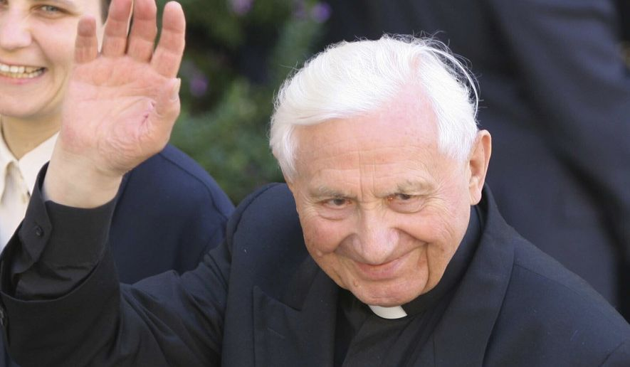 In this Monday, Aug. 15, 2005, filer, the Rev. Georg Ratzinger, brother of Pope Benedict XVI, waves as he walks in Castel Gandolfo, near Rome, where the pontiff greeted the faithful for Assumption day celebrations. The Rev. Georg Ratzinger, the older brother of Emeritus Pope Benedict XVI, who earned renown in his own right as a director of an acclaimed German boys choir, has died at age 96. The Regensburg diocese in Bavaria, where Ratzinger lived, said in a statement on his website that he died on Tuesday, June 30, 2020. (AP Photo/Alessandra Tarantino, File)