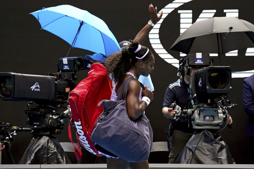 In this Jan. 24, 2020, file photo, Serena Williams waves as she leaves Rod Laver Arena after a third round loss to China's Wang Qiang at the Australian Open tennis championship in Melbourne, Australia. (AP Photo/Lee Jin-man, File)  **FILE**