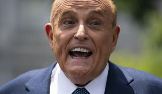 Rudy Giuliani, an attorney for President Donald Trump, talks with reporters outside the White House, Wednesday, July 1, 2020, in Washington. (AP Photo/Evan Vucci)