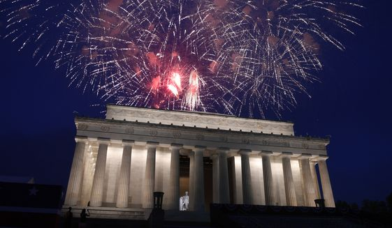 In this July 4, 2019, file photo, fireworks go off over the Lincoln Memorial in Washington. The Trump administration is promising one of the largest fireworks displays in recent memory for Washington on July 4. It also plans to give away as many as 300,000 face masks to those who come down to the National Mall, although they won't be required to wear them. (AP Photo/Susan Walsh)