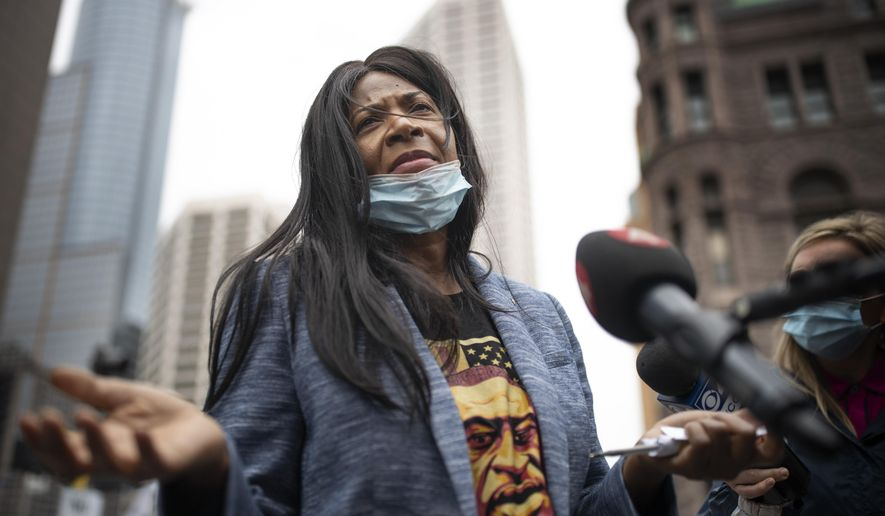 George Floyd's aunt Angela Harrelson, of Minneapolis, speaks with reporters outside the Hennepin County Public Safety Facility on Monday morning, June 29, 2020, in Minneapolis. A Minnesota judge on Monday warned that he's likely to move the trials of four former police officers charged in Floyd's death out of Minneapolis if public officials, attorneys and family members don't stop speaking out about the case. (Jerry Holt/Star Tribune via AP)