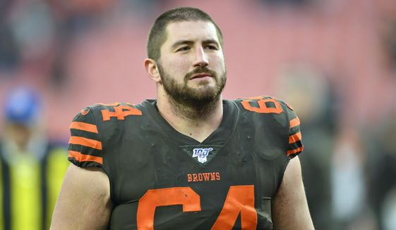 "FILE - In this Dec. 8, 2019, file photo, Cleveland Browns center JC Tretter walks off the field after an NFL football game against the Cincinnati Bengals in Cleveland. NFLPA president JC Tretter warned players they have to ""fight for necessary COVID-19 protections"" and Malcolm Jenkins said ""football is nonessential."" With training camp less than a month away, some players are speaking out about concerns over playing football during a pandemic while others are ignoring medical advice and holding workouts with teammates.  (AP Photo/David Richard, File)  **FILE**"