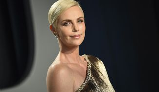 "FILE - This Feb. 9, 2020 file photo shows actress Charlize Theron at the Vanity Fair Oscar Party in Beverly Hills, Calif. Theron stars and produces the Netflix action thriller ""The Old Guard,"" streaming on July 10. (Photo by Evan Agostini/Invision/AP, File)"