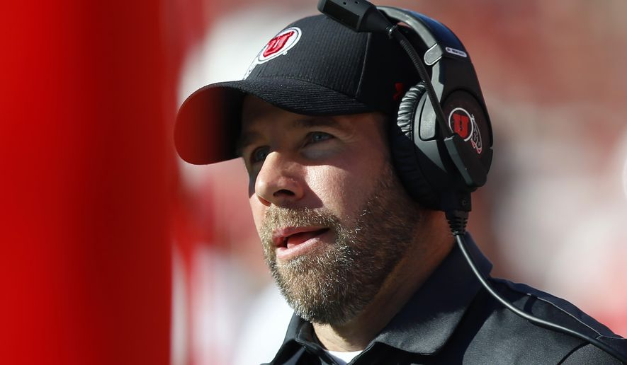 FILE - In this Saturday, Sept. 14, 2019 file photo, Utah defensive coordinator Morgan Scalley looks on in the second half of an NCAA college football game against Idaho State in Salt Lake City. Utah defensive coordinator Morgan Scalley will remain on staff but will take a pay cut and must undergo diversity training after being suspended for using a racial slur in a 2013 text message. Utah announced Wednesday, July 1, 2020 that Scalley will participate in diversity and inclusion education and have his salary cut from $1.1 million to $525,000.(AP Photo/Rick Bowmer, File)