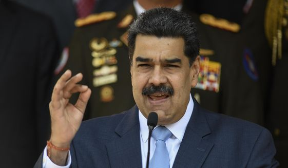 In this March 12, 2020, file photo, Venezuelan President Nicolas Maduro speaks during a press conference at the Miraflores Presidential Palace in Caracas, Venezuela. (AP Photo/Matias Delacroix, File)