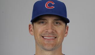 FILE - This 2020 file photo shows Tommy Hottovy of the Chicago Cubs baseball team. An emotional Chicago Cubs pitching coach Tommy Hottovy is recovering from a severe case of COVID-19 that left him quarantined for 30 days. The 38-year-old Hottovy broke down as he detailed a harrowing ordeal during a conference call on Wednesday, July 1, 2020. (AP Photo/Gregory Bull, File)