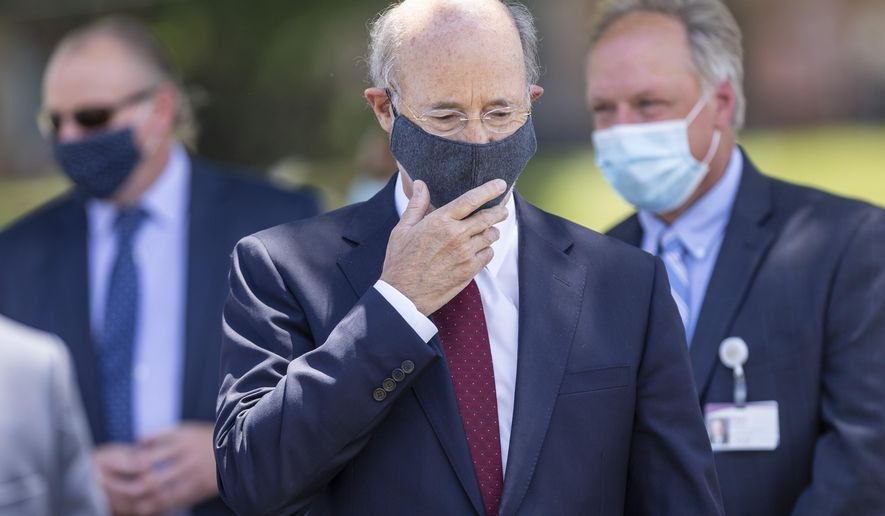 Pennsylvania Gov. Tom Wolf prepares to speak at a press conference outside UPMC Pinnacle Community Osteopathic Hospital in Lower Paxton Twp, Pa,. on Monday, June 29, 2020. (Joe Hermitt/The Patriot-News via AP)