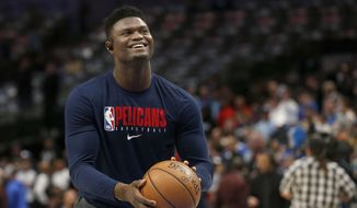 In this March 4, 2020, file photo, New Orleans Pelicans forward Zion Williamson shoots free throws prior to an NBA basketball game against the Dallas Mavericks in Dallas. Pelicans rookie Williamson says he feels like he is in good shape as he prepares to help lead New Orleans' eight-game push to make the NBA playoffs. (AP Photo/Michael Ainsworth) ** FILE **