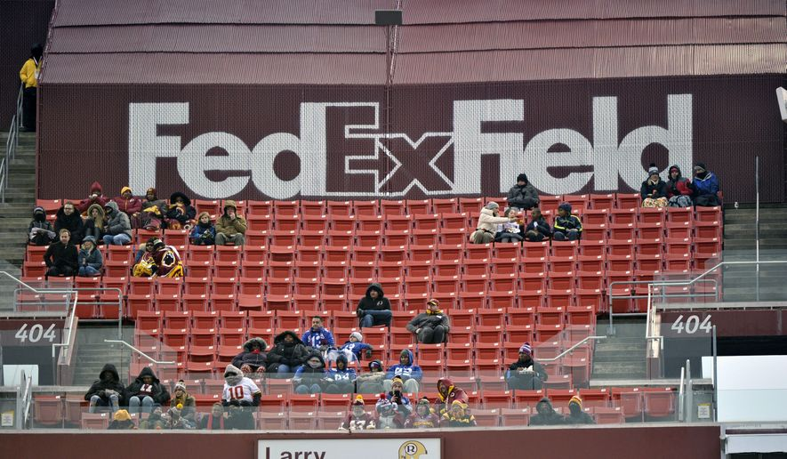 """In this Dec. 9, 2018, file photo, FedEx Field is less than full during the second half of an NFL football game between the Washington Redskins and the New York Giants in Landover, Md. The title sponsor of the Redskins' stadium wants them to change their name. FedEx said in a statement Thursday, July 2, 2020, """"We have communicated to the team in Washington our request that they change the team name."""" (AP Photo/Mark Tenally, File)"""