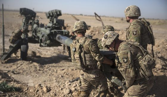 In this June 10, 2017, file photo provided by Operation Resolute Support, U.S. soldiers with Task Force Iron maneuver an M-777 howitzer, so it can be towed into position at Bost Airfield, Afghanistan. Moscow and Washington are intertwined in a complex and bloody history in Afghanistan, with both suffering thousands of dead and wounded in conflicts lasting for years. Now both superpowers are linked again over Afghanistan, with intelligence reports indicating Russia secretly offered bounties to the Taliban to kill American troops there. (U.S. Marine Corps photo by Sgt. Justin T. Updegraff, Operation Resolute Support via AP, File)