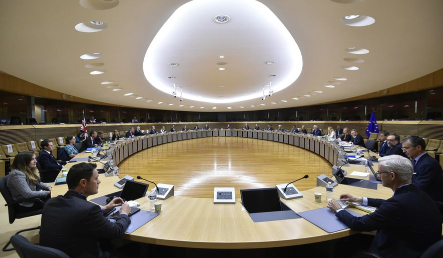 European Union's Brexit negotiator Michel Barnier and British Brexit negotiator David Frost attend a meeting with their delegations on further Brexit negotiations at EU headquarters in Brussels, Monday, June 29, 2020. European Union and U.K. negotiators resumed in-person talks on a post-Brexit trade deal on Monday, with both sides insisting that the process must accelerate markedly if they're to reach an agreement by the end of the year. (John Thys, Pool Photo via AP)