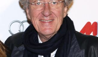 CORRECTS THE AMOUNT TO MILLION, NOT BILLION -FILE - In this Aug. 2, 2012, file photo, Australian actor Geoffrey Rush arrives for the opening of the Melbourne International Film Festival in Melbourne, Australia. An Australian court on Thursday, July 2, 2020, rejected a newspaper publisher's appeal against Oscar-winning actor Rush's $2.9 million Australian dollars ($2 million) payout for defamation. (AP Photo/Paul Jeffers, File)
