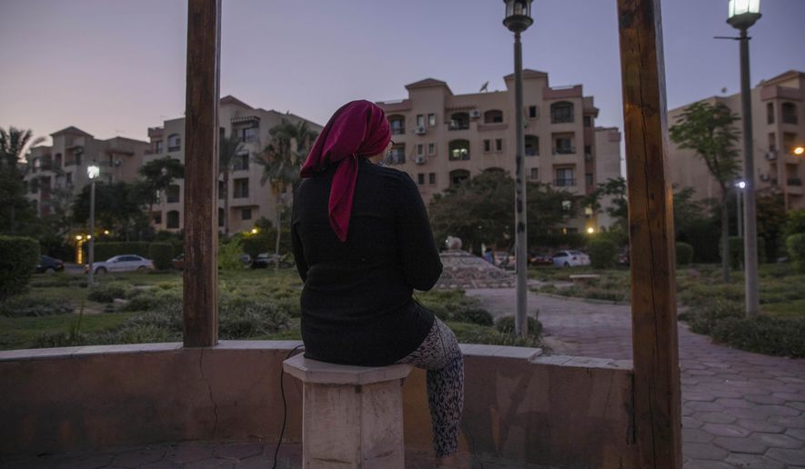 Noha, an Egyptian engineer, who was chosen to be among the U.S. government's roughly 50,000 visa lottery winners this year, speaks during an interview near her home in Cairo, Egypt, Tuesday, June 30, 2020. While visas for Noha and her children came in February, Ahmed, her husband, has not arrived and now they fear it may never come. President Donald Trump in June halted visas from being issued outside the United States through the end of the year. (AP Photo/Nariman El-Mofty)
