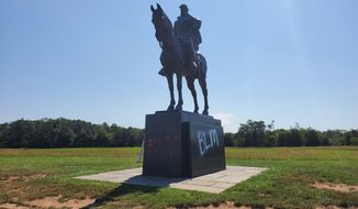 """A statue of Stonewall Jackson at Manassas National Battlefield was vandalized with the letters """"BLM"""" painted on the base. (National Park Service)"""