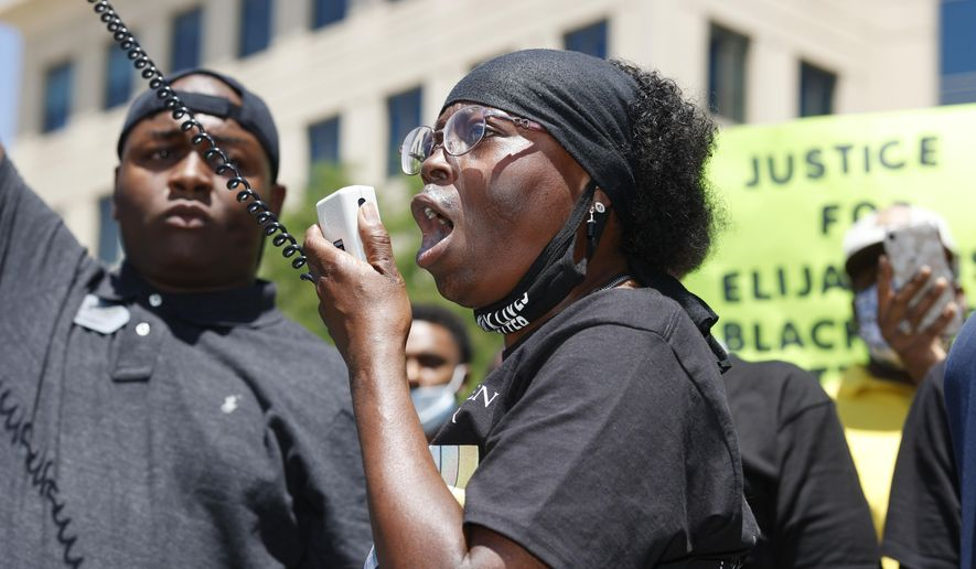 In this June 27, 2020, file photo, Sheneen McClain speaks during a rally and march over the death of her 23-year-old son Elijah McClain, outside the police department in Aurora, Colo. One of the police officers investigated over photographs connected with Elijah McClain's death has resigned, Aurora police said Thursday, July 2, 2020. (AP Photo/David Zalubowski, File)