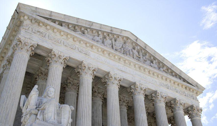 The U.S. Supreme Court is seen Tuesday, June 30, 2020, in Washington. (AP Photo/Manuel Balce Ceneta)