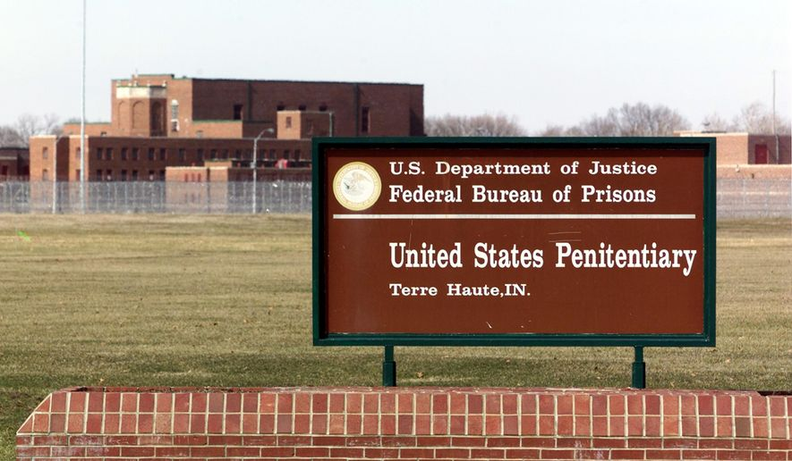 In this May 16, 2001, file photo, the entrance to the U.S. Penitentiary in Terre Haute, Ind. A Zen Buddhist priest wants a federal judge to stop the execution of a federal death row inmate he's been counseling and argues he would be put at high risk for the coronavirus if the execution happens this month. Dale Hartkemeyer goes by the religious name Seigen. He filed a lawsuit Thursday in federal court in Indiana. The 68-year-old wants the court to delay Wesley Ira Purkey's execution until a coronavirus vaccine is available or there's a widespread effective treatment. Purkey is one of four federal death row inmates scheduled to be executed in July and August. (AP Photo/Michael Conroy, File)