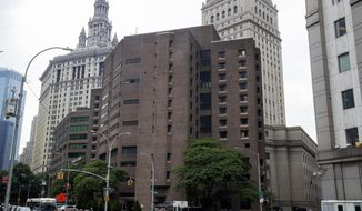 FILE - This Aug. 13, 2019, file photo shows New York City's Metropolitan Correctional Center. On Thursday, July 2, 2020, U.S. District Judge Edgardo Ramos said that federal lockup failed to implement common-sense measures to protect prisoners after a COVID-19 outbreak infected dozens of inmates at the facility and will allow a lawsuit brought by four inmates to proceed. (AP Photo/Mary Altaffer, File)